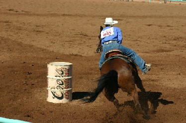 Barrel racing event at the Sierra Stampede Women's Professional Rodeo by Xandert